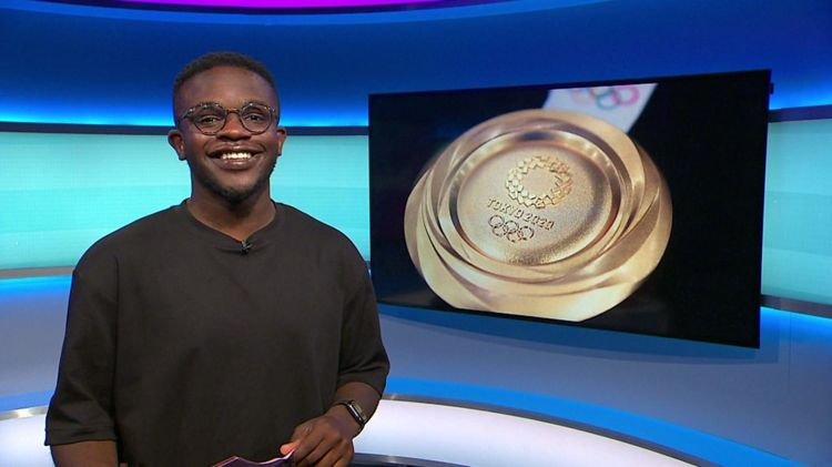 De-Graft on the Newsround set with a picture of a gold medal