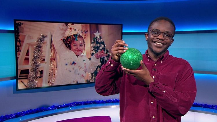 De'Graft on the Newsround with a christmas pic and bauble
