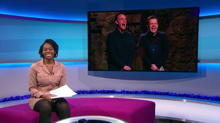 Shanequa sitting on the Newsround sofa with a picture of Ant and Dec