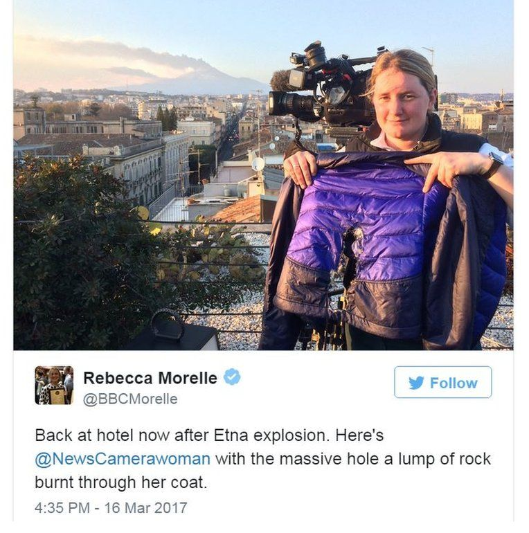 BBC's correspondent Rebecca Morelle tweets a picture of camera woman with hole burnt in jacket from lava