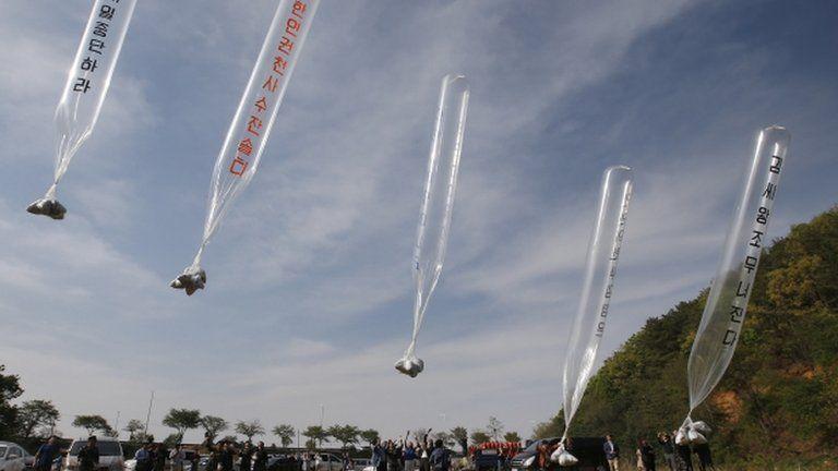 Ballons flying across the border