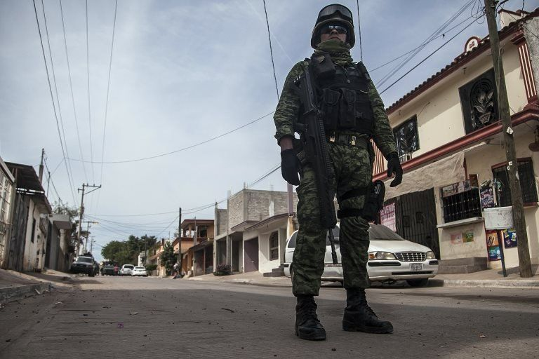 Mexican soldiers patrol during an operation against alleged members of organized crime in Culiacan, Sinoaloa state, Mexico on February 16, 2018