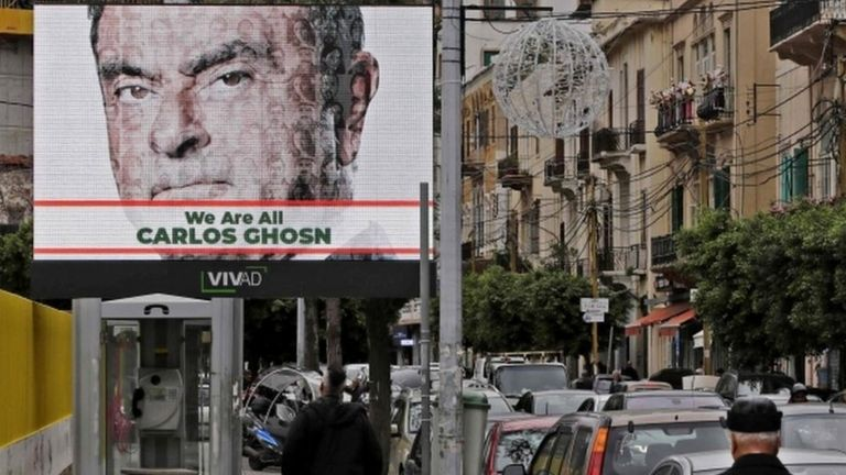 Image shows a portrait of Carlos Ghosn on a publicity billboard in his support on a street in Beirut