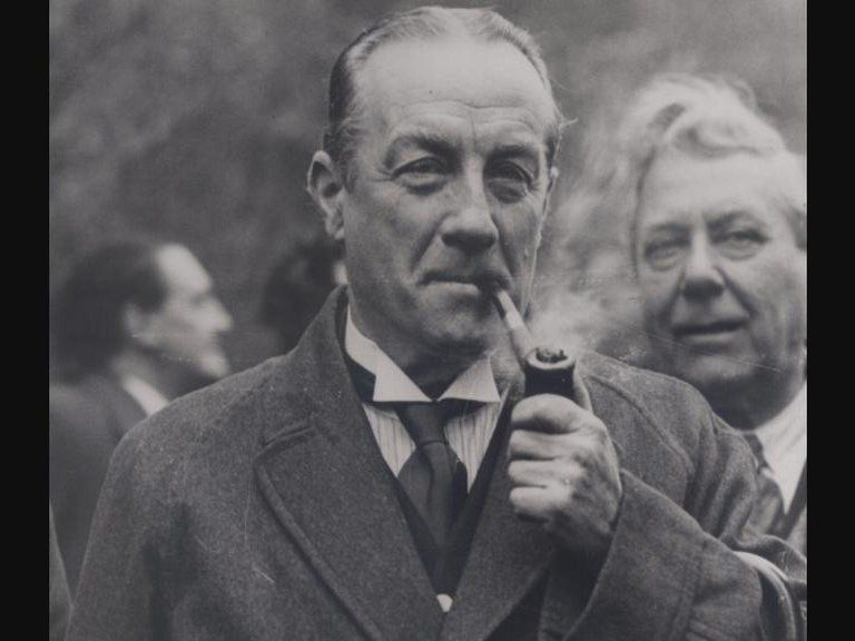 Picture of Stanley Baldwin smoking a pipe