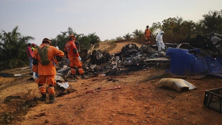 """picture released by Colombia""""s Civil Defense press service showing members of civil defense at the site of a plane DC-3 crash in San Martin"""