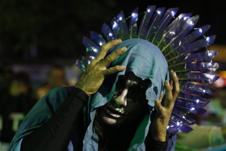 An artists dressed as La Llorona, the Weeping Woman of legend
