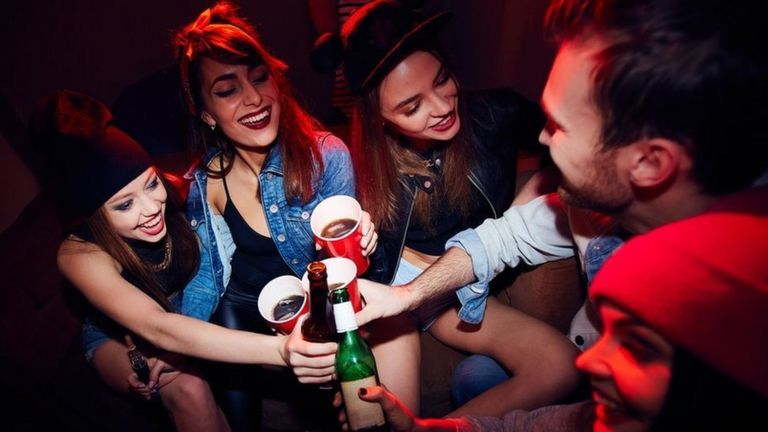 Students drinking (stock photo)