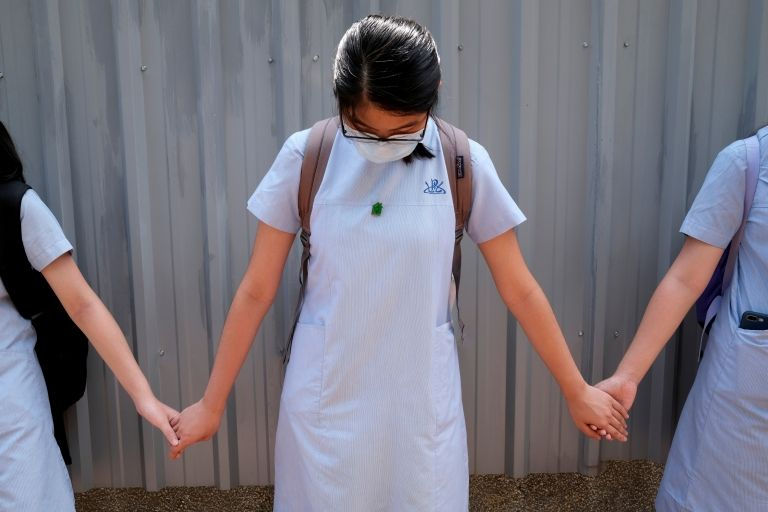 File photo of students forming a human chain in protests in June