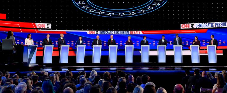From left to right: Tulsi Gabbard, Tom Steyer, Cory Booker, Kamala Harris, Bernie Sanders, Joe Biden, Elizabeth Warren, Pete Buttigieg, Andrew Yang, Beto O'Rourke, Amy Klobuchar, and Julian Castro participate in the fourth Democratic primary debate in Westerville, Ohio - 15 October 2019