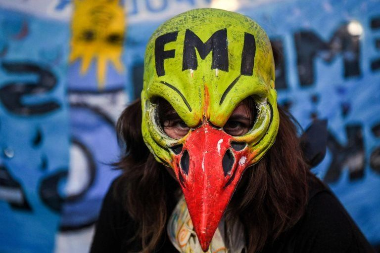 A woman demonstrates while legislators debate a bill to put a stop on public services taxes raising in Buenos Aires, on May 09, 2018.
