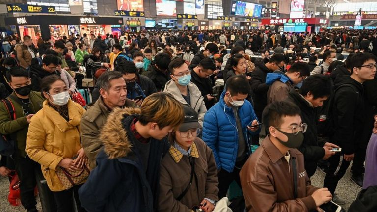 People wait to board trains at Hongqiao Railway Station in Shanghai on January 20, 2020, ahead of the Lunar New Year