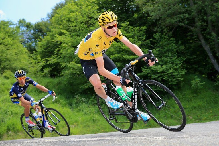 Chris Froome riding a Pinarello bike during a Tour de France stage
