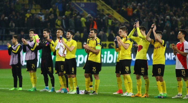 Dortmund applaud the fans after their defeat