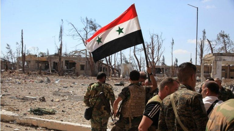 Syrian soldiers with Syrian flag in Aleppo (file photo)
