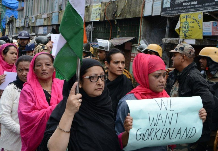 Protesters take part in a rally in support of a separate state of Gorkhaland in Darjeeling on June 18, 2017.