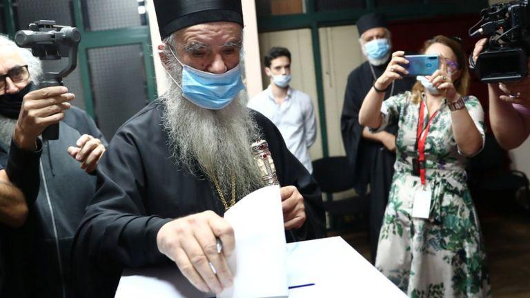 Metropolitan Amfilohije, the Serbian Orthodox Church's top cleric in Montenegro, casts his ballot