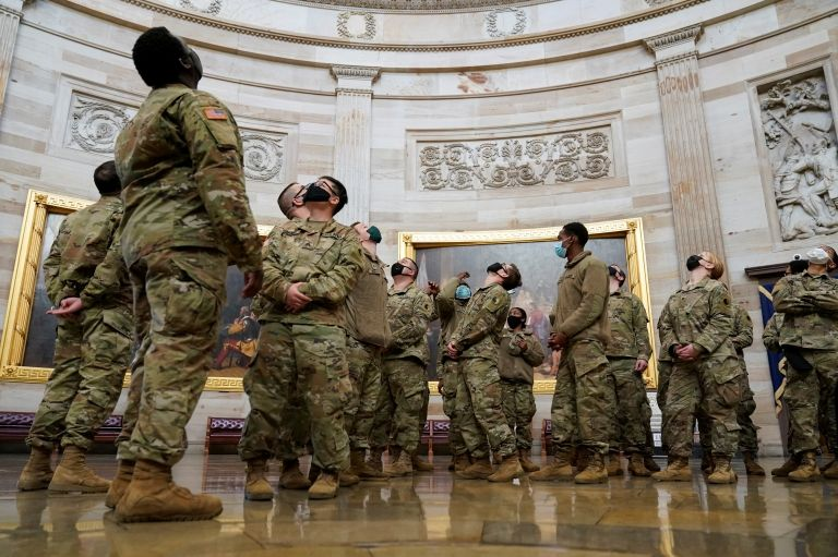 Soldiers stare up at ceiling of US Capitol building