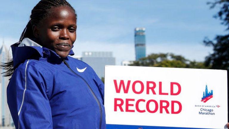 Kenya's Brigid Kosgei smiles after winning the women's 2019 Chicago Marathon - 13 October 2019