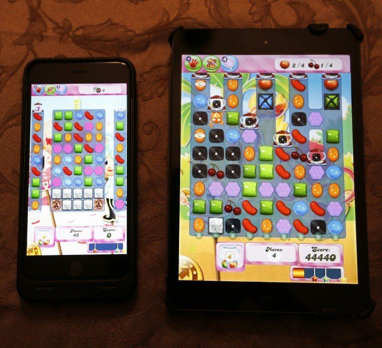 Candy Crush Saga game on smartphone and tablet