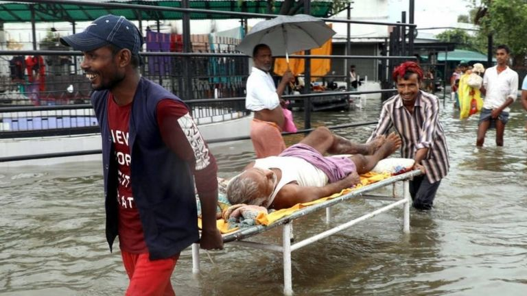 People navigate flooded streets in Bihar