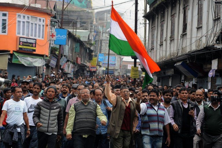 Supporters of the separatist Gorkha Janmukti Morcha (GJM) group take part in a rally to honour protesters they say were killed during clashes with security forces a day earlier, in Darjeeling on June 18, 2017.