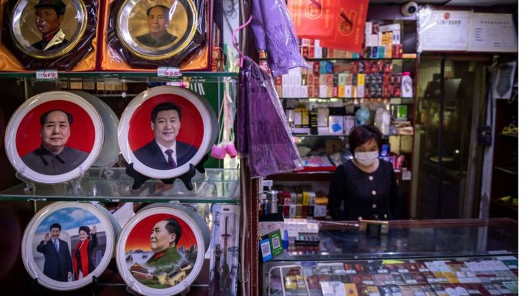 A souvenir show with plates on display with the picture of Chinese President Xi Jinping and the late Communist Party leader Mao Zedong.
