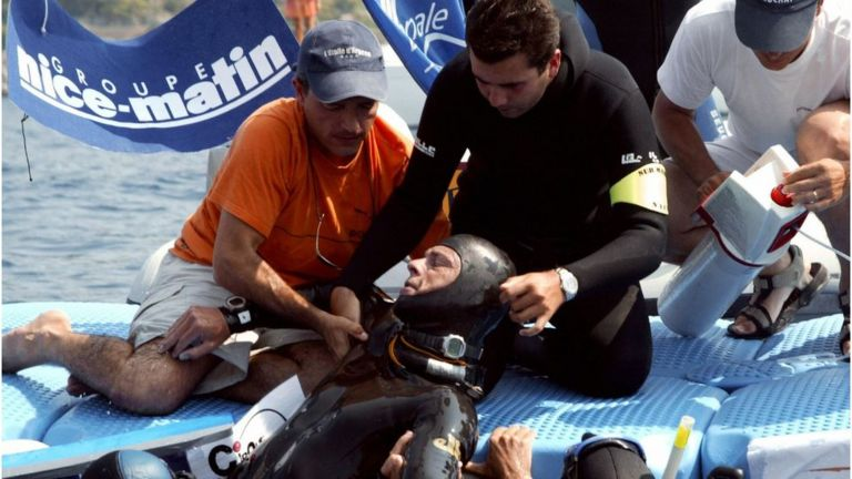Herbert Nitsch, is helped after fainting at a depth of 107 meters during the men's individual free-diving world championships in the southern French city of Villefranche-sur-Mer in 2004