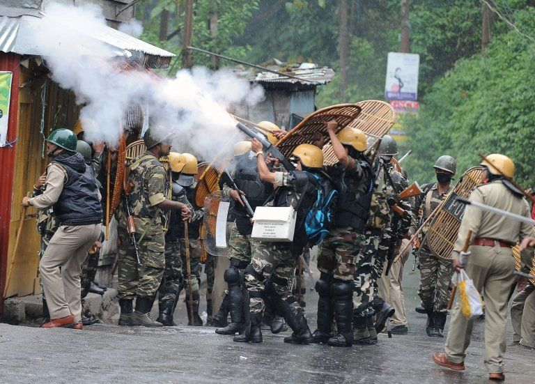 Indian security forces fire tear gas canisters during clashes with supporters of the separatist Gorkha Janmukti Morcha (GJM) group in Darjeeling on June 17, 2017.
