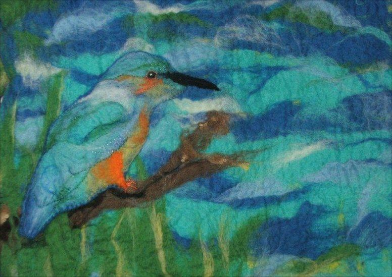 A picture of a kingfisher made from different coloured felt