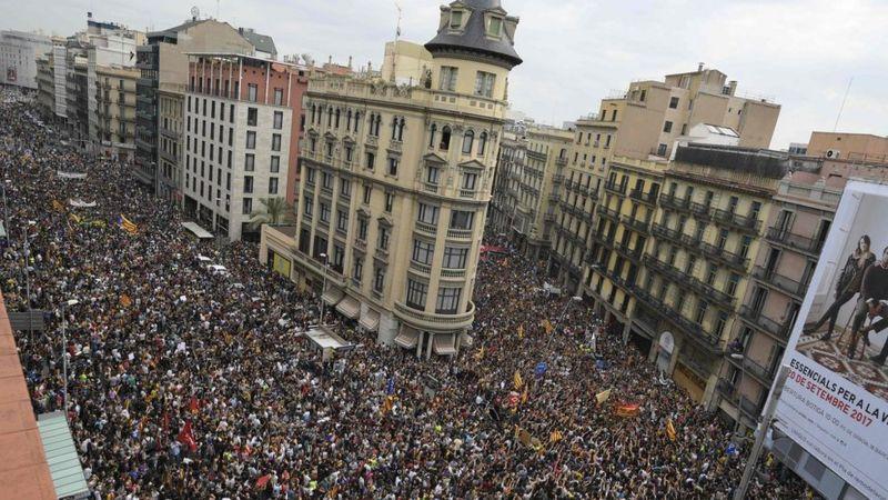 Protesters gather at the Place de la Universitat square in Barcelona on 3 October