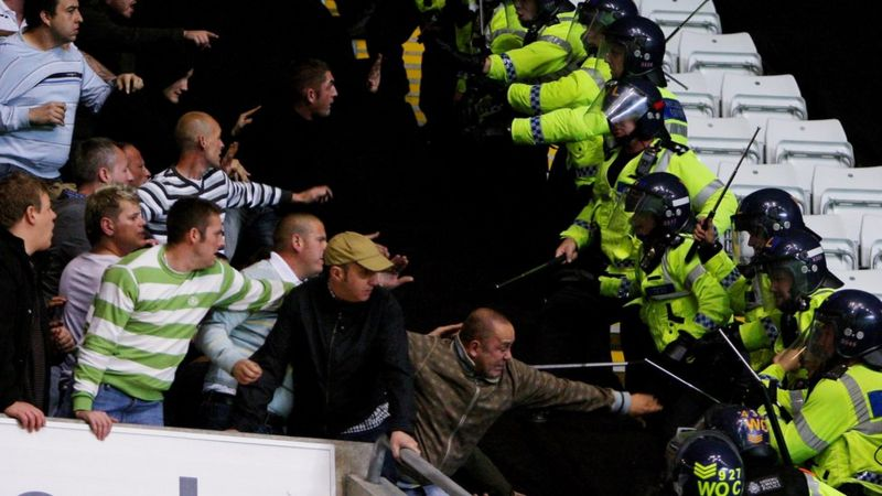 Fans fighting with police