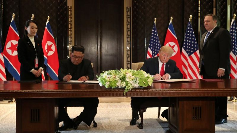 "U.S. President Donald Trump and North Korea""s leader Kim Jong Un sign documents that acknowledge the progress of the talks and pledge to keep momentum going,"