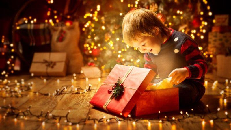 boy-opening-gift