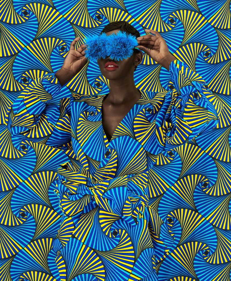 Woman disguised by swirling fabric