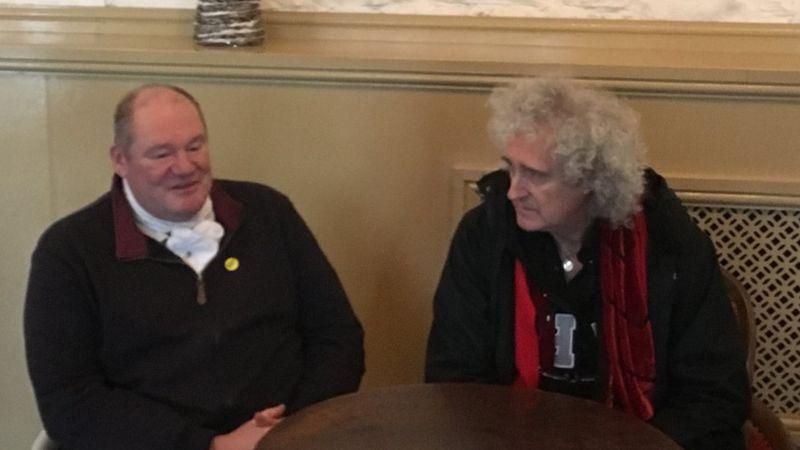 Byron John chatting with Brian May
