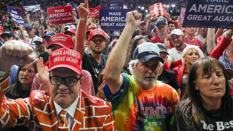 Supporters hold up signs during a campaign rally for President Donald Trump at the BOK Center, June 20, 2020 in Tulsa, Oklahoma