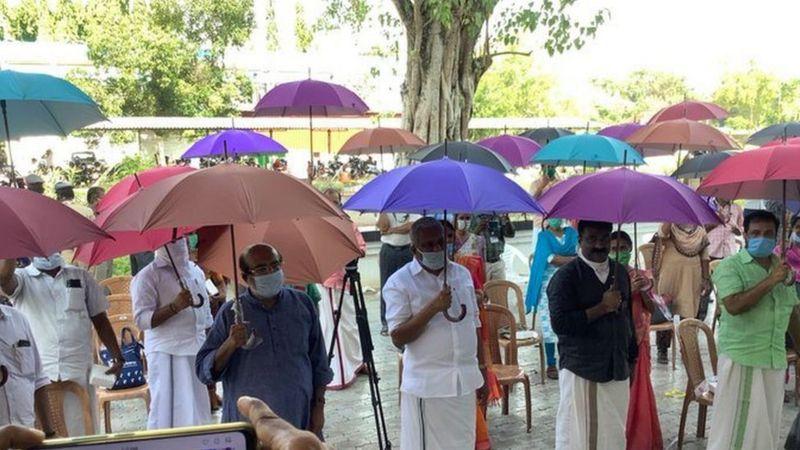 People-in-India-holding-umbrellas.