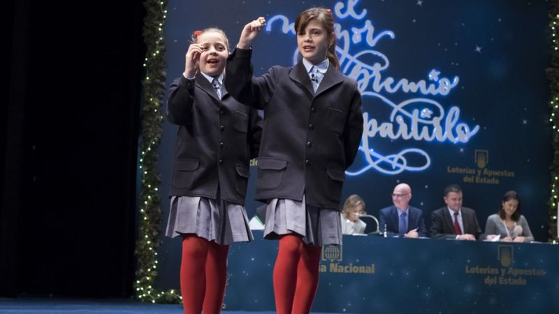 Children read out the numbers in the 2015 Christmas lottery in Spain, called El Gordo