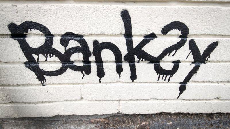 Graffiti of Banksy's name.