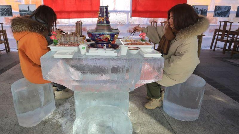 Women eating in the ice hotpot restaurant.