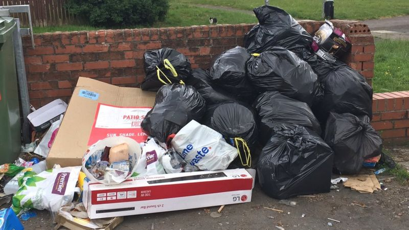 Rubbish dumped by bins on the Wildmill estate in Bridgend