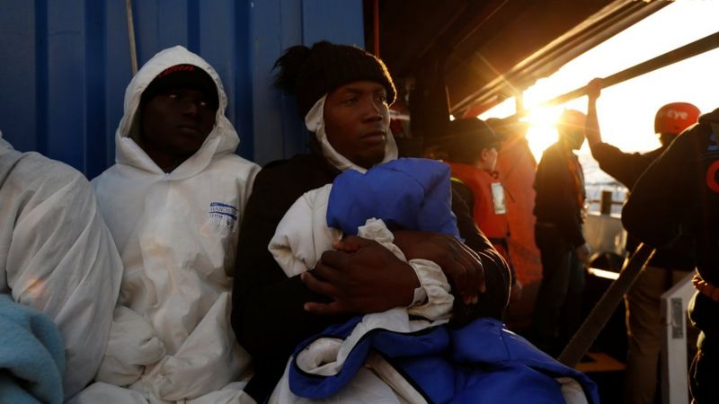 "Rescued migrants rest on the migrant rescue ship ""Alan Kurdi"""