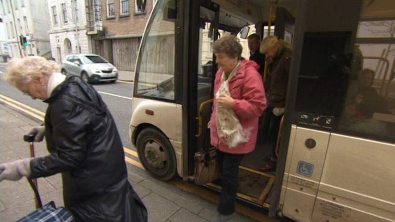 Photo of bus passengers disembarking