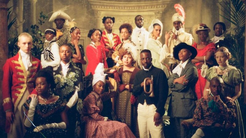 A group picture of the cast of Black to Life is costume