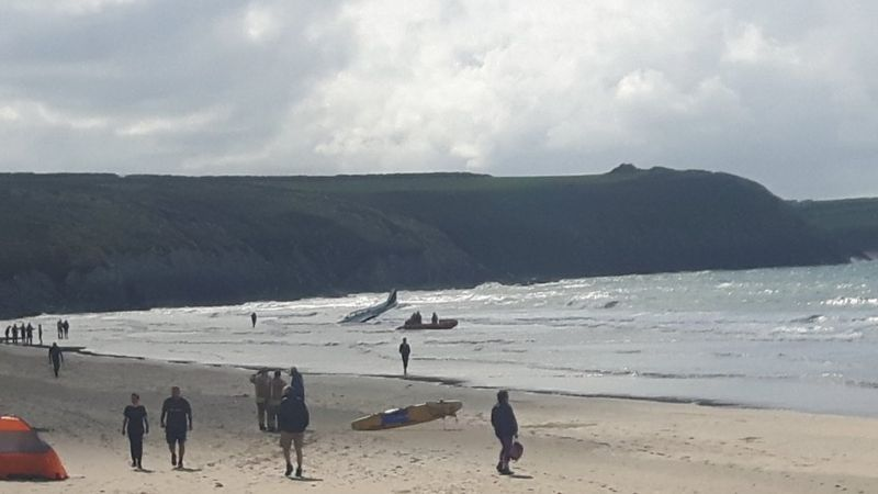 A plane in the sea at Whitesands Bay