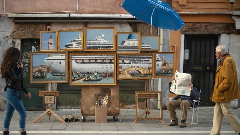 Banksy shows off new artwork of giant cruise ship in the middle of Venice.