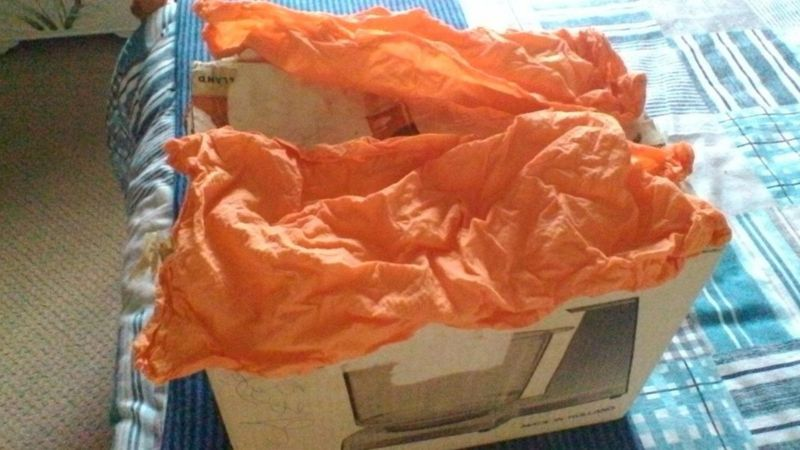 The old storage box and orange kitchen towel