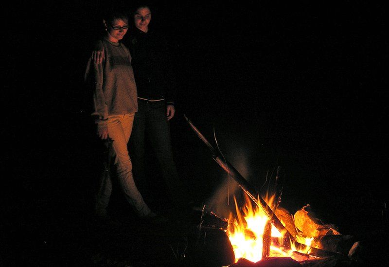 People by a fire