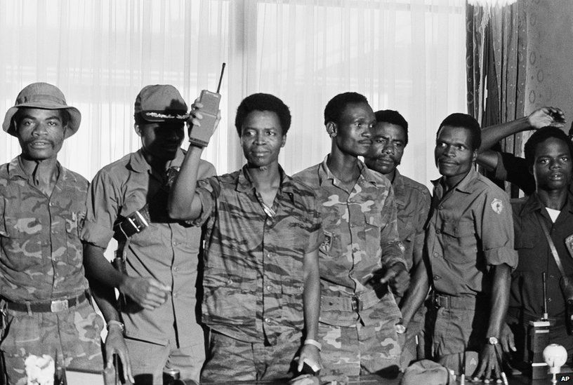 """Master Sgt. Samuel K. Doe, Liberia new chief of state, flourished walkie-talkie radio, as he posed with members of the ruling """"People's Redemption Council,"""" shortly after the April 12, 1980 overthrow of President Willium R Tolbert Jr."""