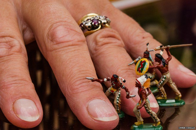 Toy soldiers and a hand